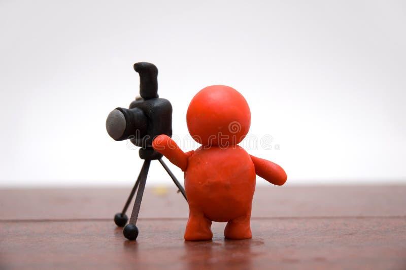 Plasticine man. Plasticine photographer with his camera stock photography