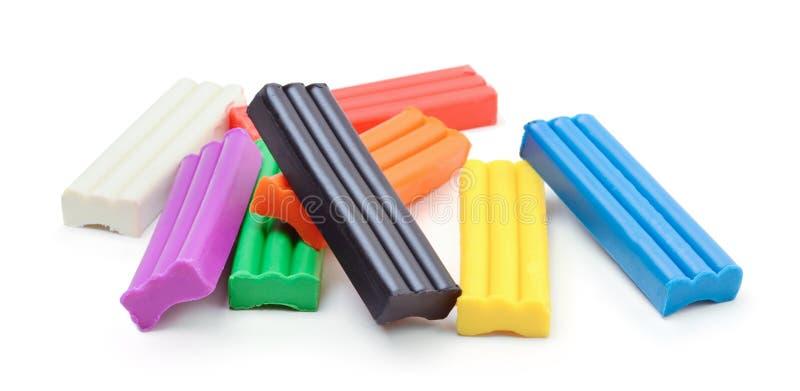 Plasticine multicolor Aislado en un blanco fotos de archivo libres de regalías