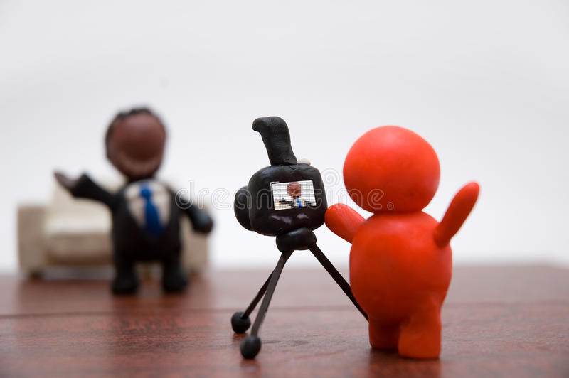 Plasticine photographer with businessman. Plasticine photographer take a shot of businessman royalty free stock image