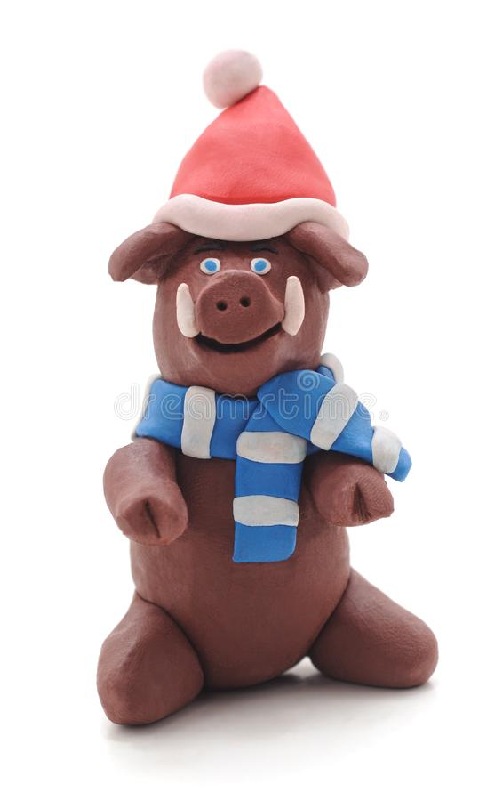 Plasticine pig in a hat royalty free stock photos