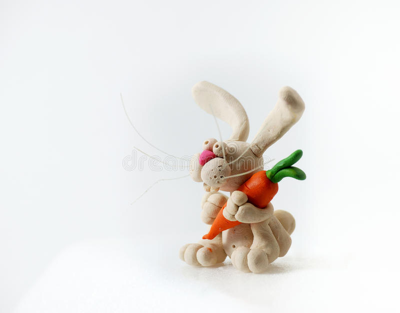Plasticine rabbit. Plasticine rabbit on a white background stock image