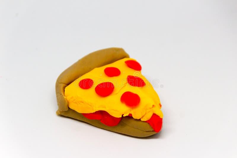 Plasticine slice of pizza photograph stock photo