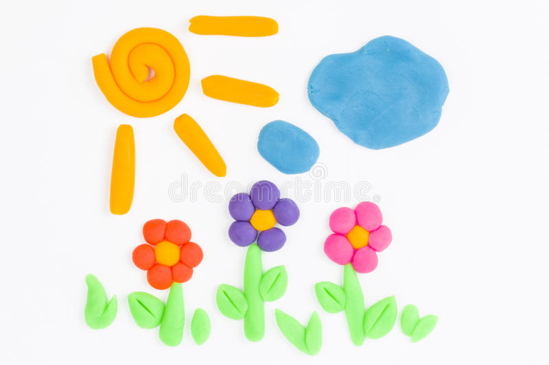 Plasticine sun, sky, cloud and flower. royalty free stock image