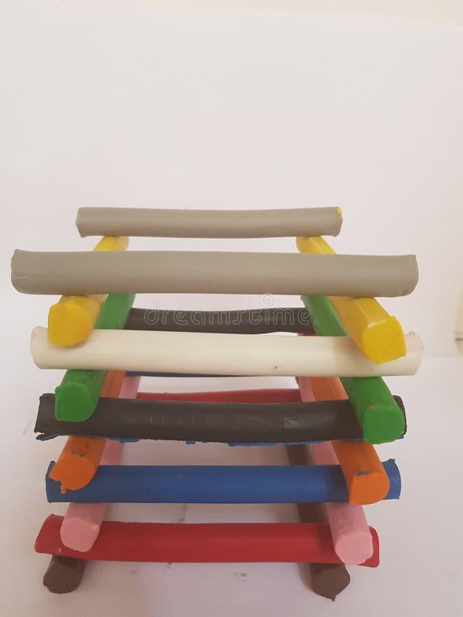 Plasticinestangen gestapelt in der Vielzahl von Farben stockbilder