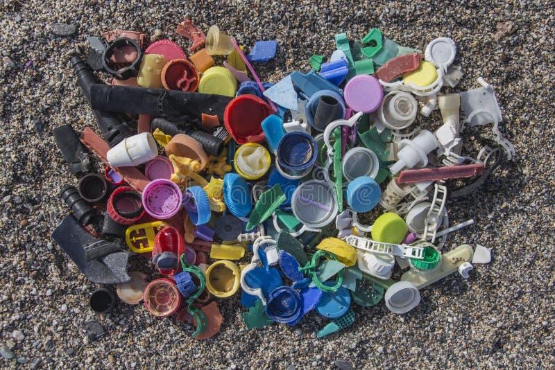 Plastics thrown on the beach stock photo