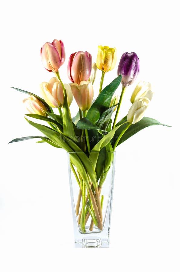 Plastikblume im Vase lokalisiert stockbild