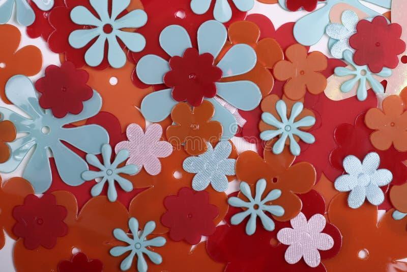 Plastikblumenhintergrund lizenzfreie stockbilder