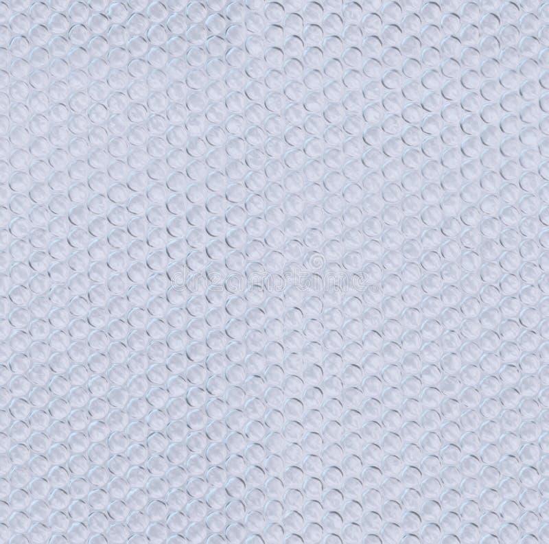 Plastikluftpolsterfolie deckte Beschaffenheit mit Ziegeln stockfotos