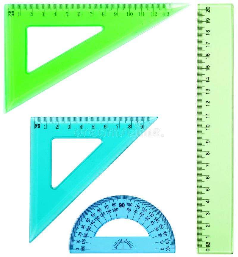 Plastikmachthaber, Winkelmesser, Dreieck, lokalisiert auf weißem backgroun lizenzfreies stockfoto