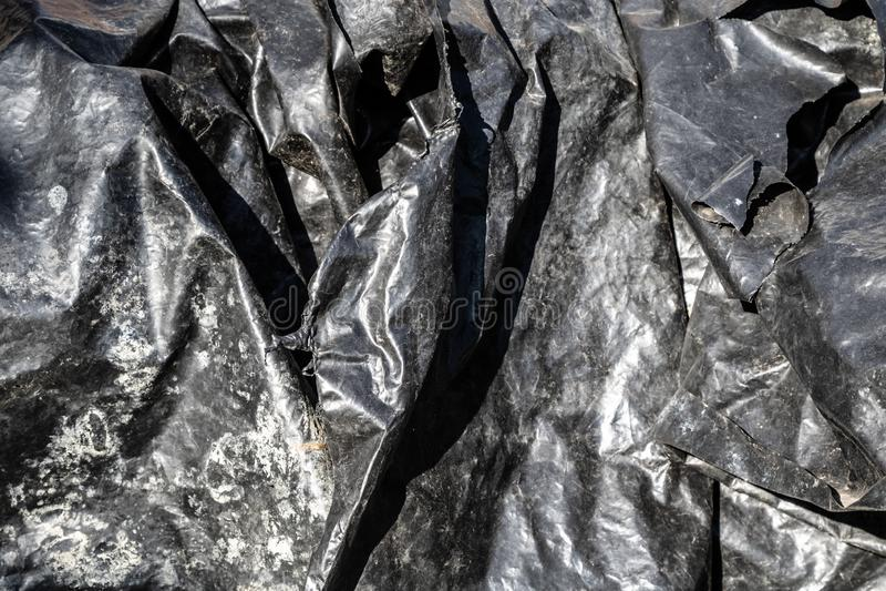 Plastikoberflächenbeschaffenheit der schwarzen Folie lizenzfreie stockbilder