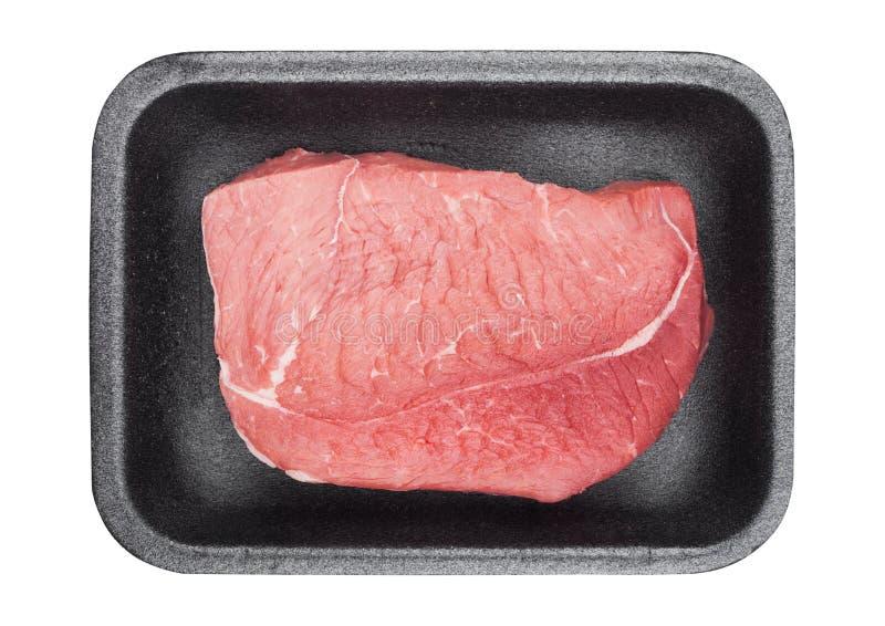 Plastikowa taca z świeżymi surowymi wołowina stku plasterkami fotografia royalty free