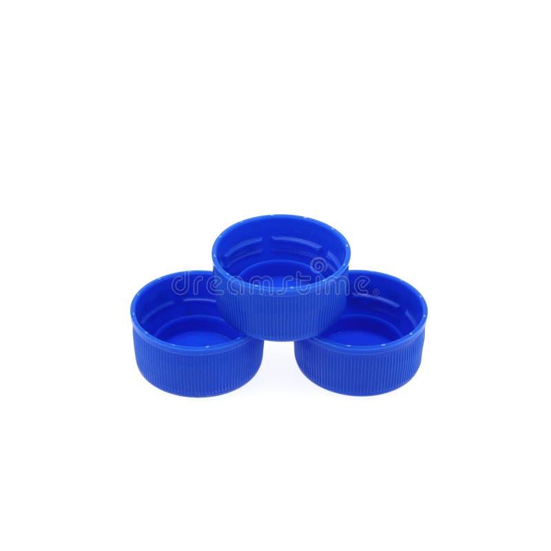 Plastikowe butelek nakrętki odizolowywać przeciw białemu tłu obrazy stock