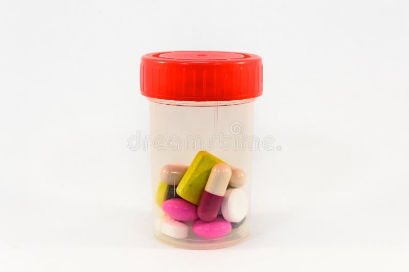 Plastikowy medycyny pudełko z czerwienią zdjęcie royalty free
