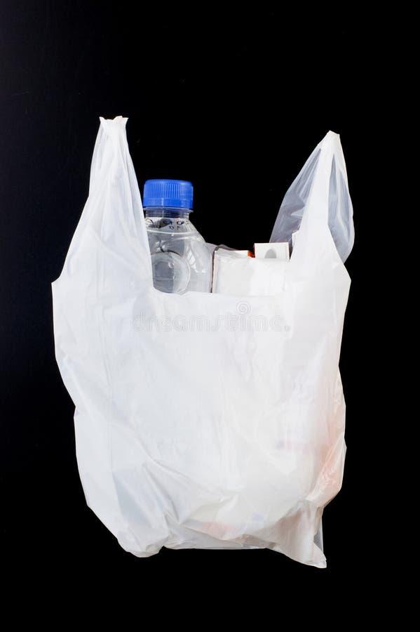 Plastiktasche, die Gebrauchsgut setzte stockbild