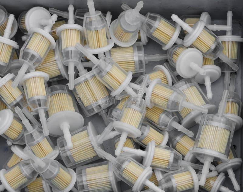 Plastique dans la ligne filtres d'essence photo libre de droits