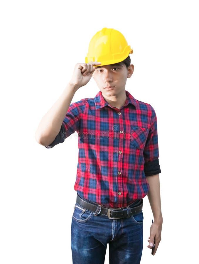 Plastique jaune de casque de sécurité de prise de crochet de main d'ingénieur sur la tête Concept de construction d'isolement sur image libre de droits