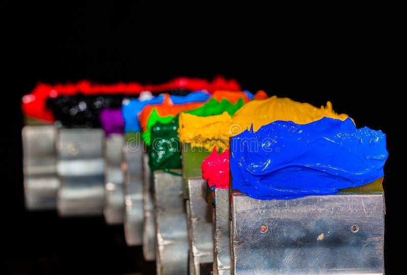 plastisolfärgpulver på tryckhandtaget arkivbilder