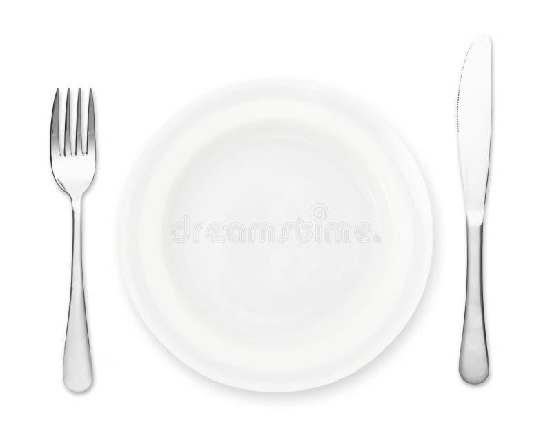 Plat avec la fourchette et le couteau photographie stock