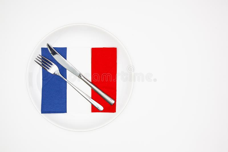 Plat blanc et drapeau français des serviettes colorées images stock