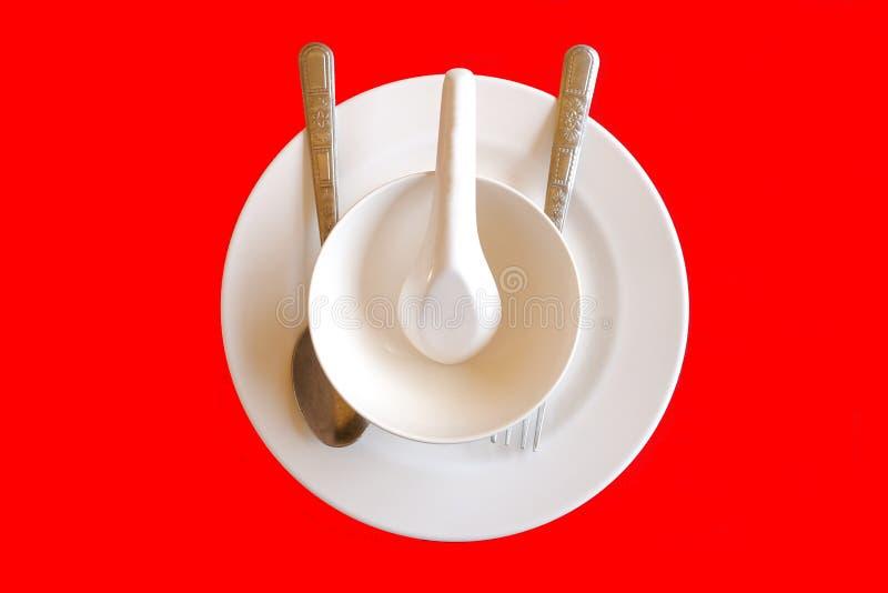 Plat, cuillère, fourchette et tasse images libres de droits