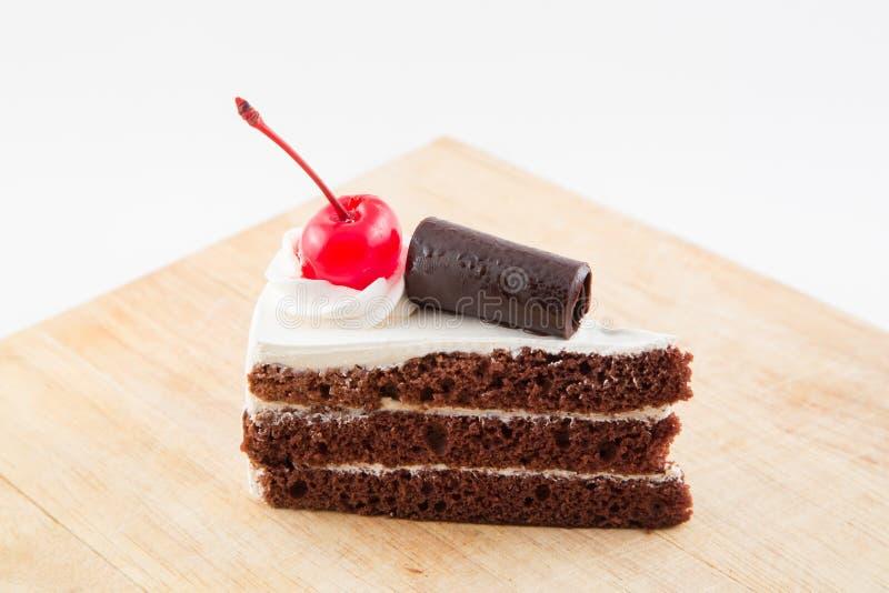 Plat délicieux en bois de gâteau de chocolat photo stock