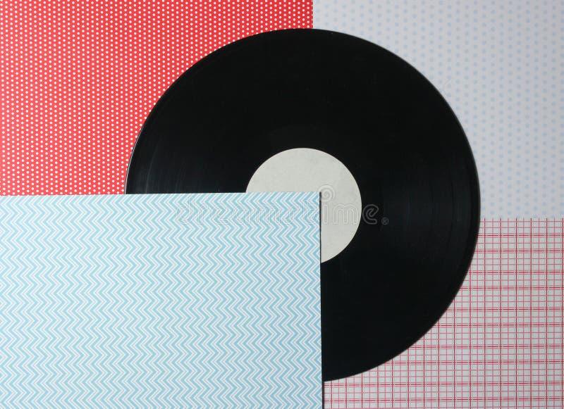 Plat de vinyle sur un fond créatif, vue supérieure photographie stock libre de droits