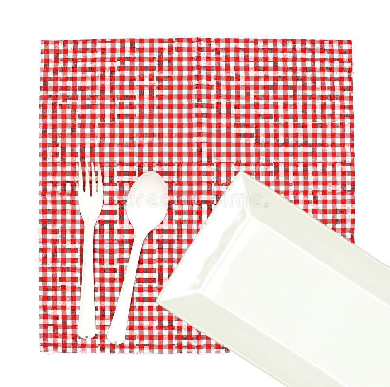 Plat de vue supérieure avec la fourchette et cuillère sur la nappe pour le servin de nourriture photos stock