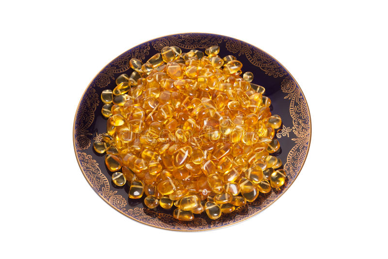 Plat foncé avec les pierres ambres jaunes photographie stock libre de droits