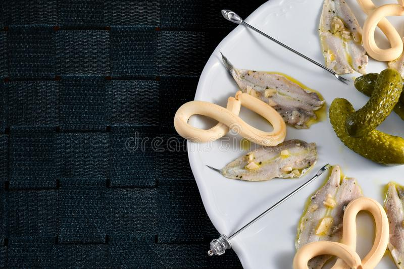 Plate of anchovies in vinegar with pickles royalty free stock image