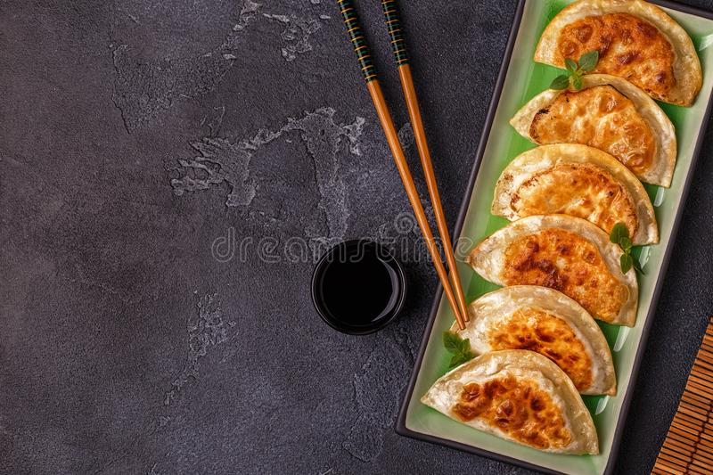 Plate of asian gyoza, dumplings snack. royalty free stock image