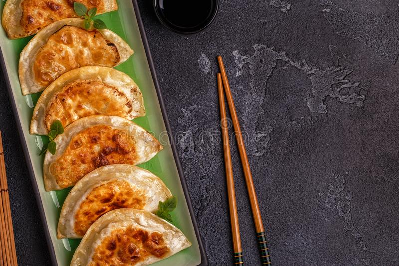 Plate of asian gyoza, dumplings snack. royalty free stock photo