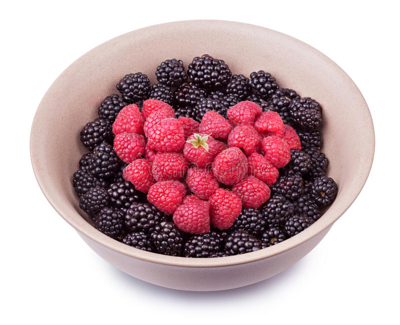 Plate with berries. Ceramic plate with heart shaped berries isolated on the white background with clipping path. Top side view stock photography