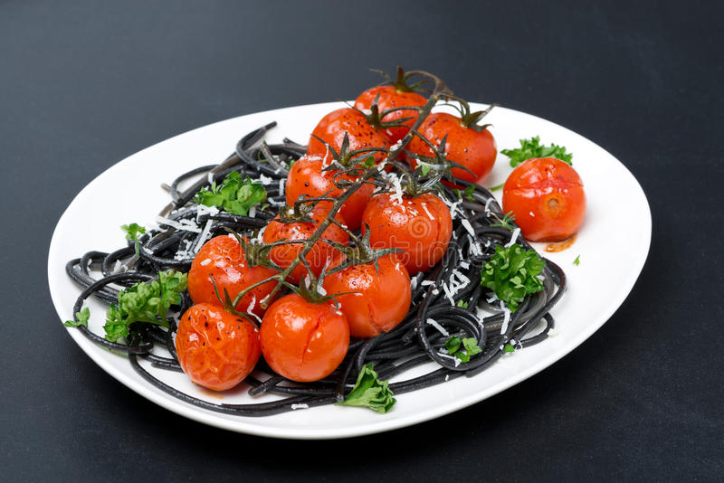 Download Plate Of Black Pasta With Baked Tomatoes, Parmesan Cheese Stock Image - Image: 41901277