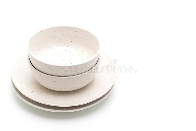 Plate and bowl isolated on white background. Empty plate and bowl isolated on white background stock photography
