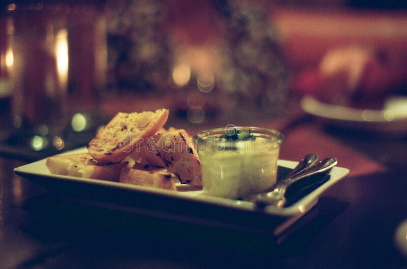Plate with bread and dip stock photography