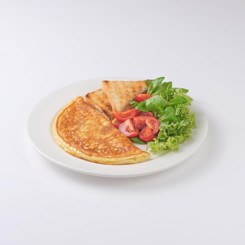 Plate of breakfast with omelette, toasts, tomato stock photo
