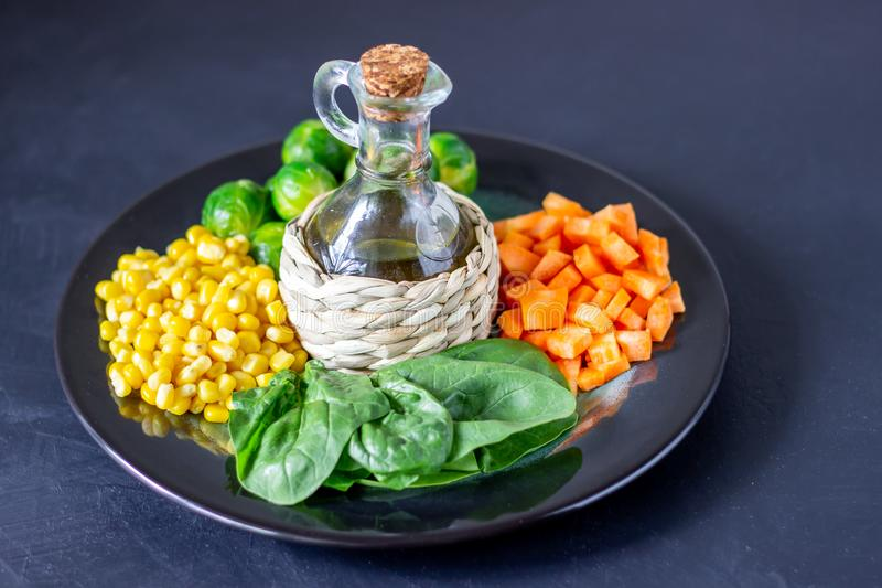 Plate with cabbage, carrots, corn and spinach. Healthy eating stock image