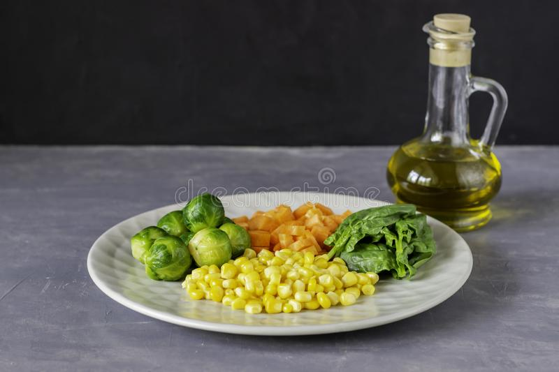 Plate with cabbage, carrots, corn and spinach. Healthy eating royalty free stock photography