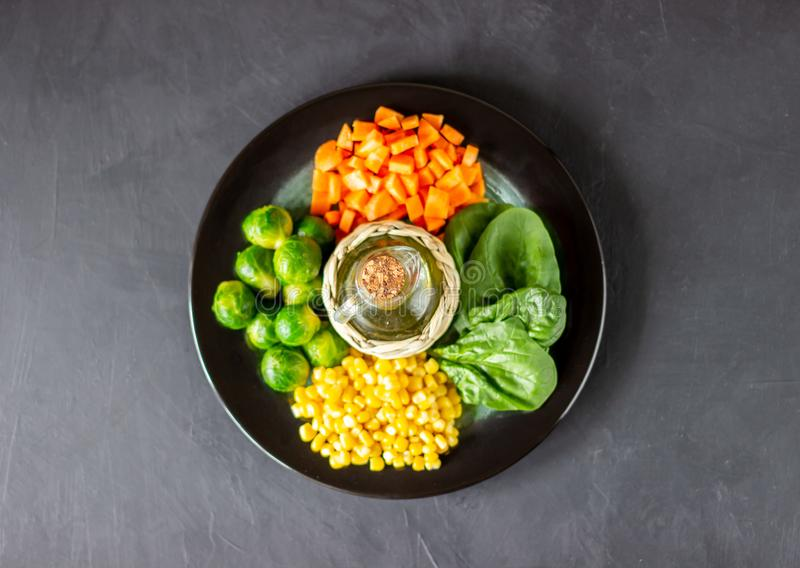 Plate with cabbage, carrots, corn and spinach. Healthy eating stock photo