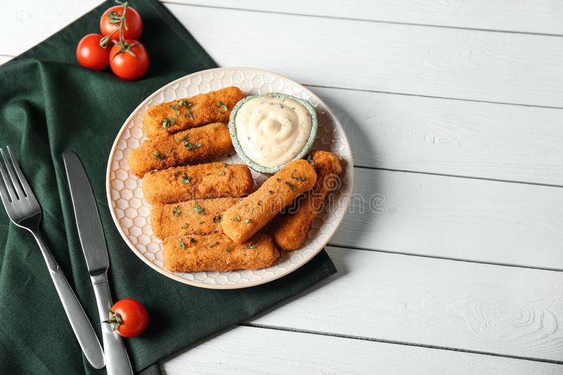 Plate of cheese sticks and sauce served on table. Space for text stock photos