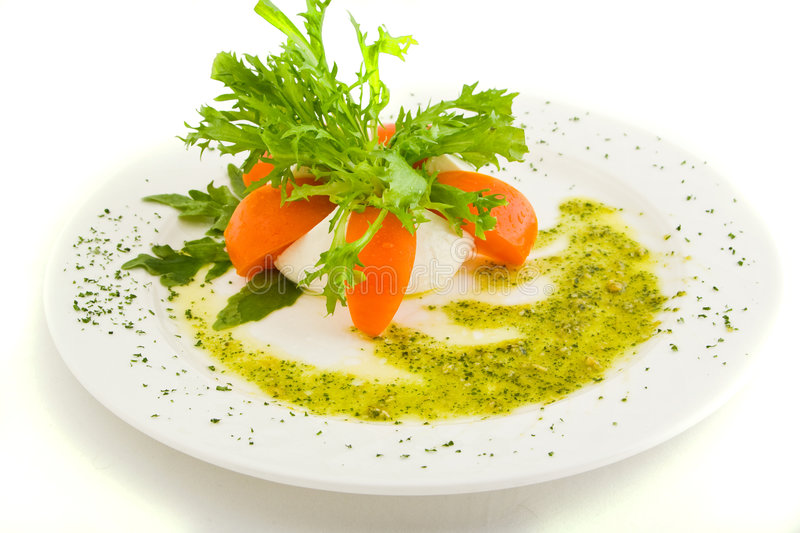 Plate with cheese, tomatoes, greens and sauce stock images