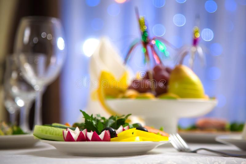 Plate with chopped vegetables. Fruit plate with blurred background stock photo