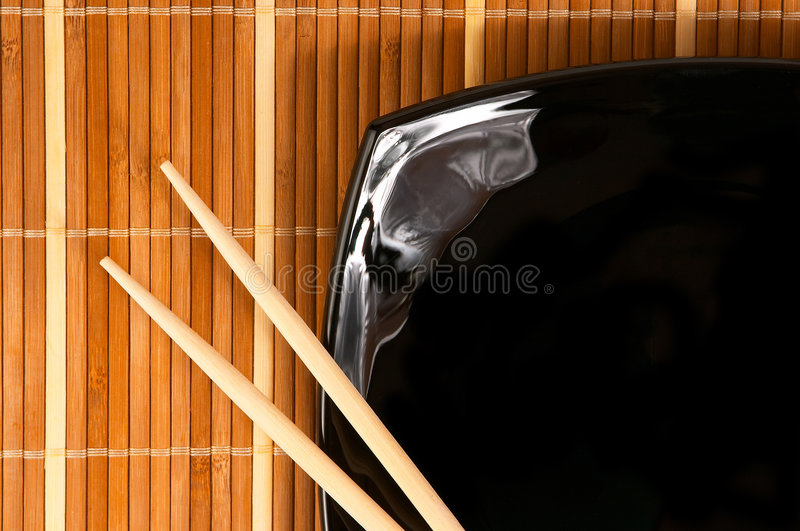 Plate with chopsticks royalty free stock images