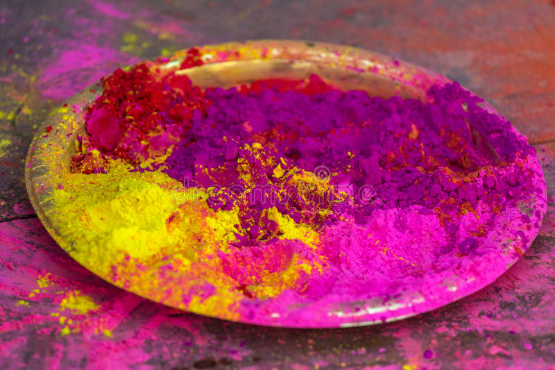 Plate with colorful dyes used for Holi festival royalty free stock image