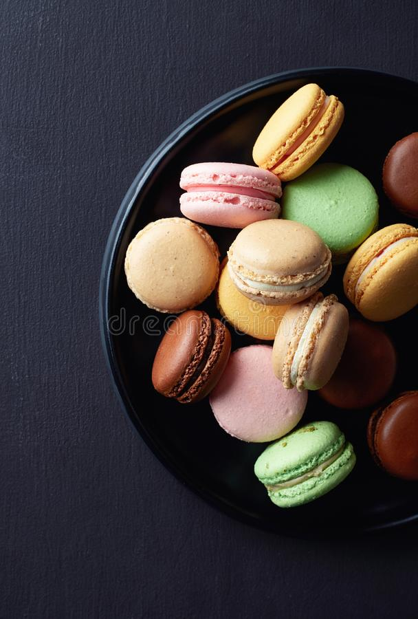 Plate of colorful macarons royalty free stock photography