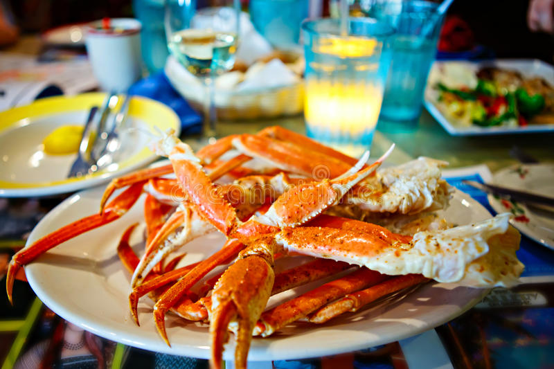 Plate with crab legs in a restaurant in Key West or New Orleans royalty free stock photography