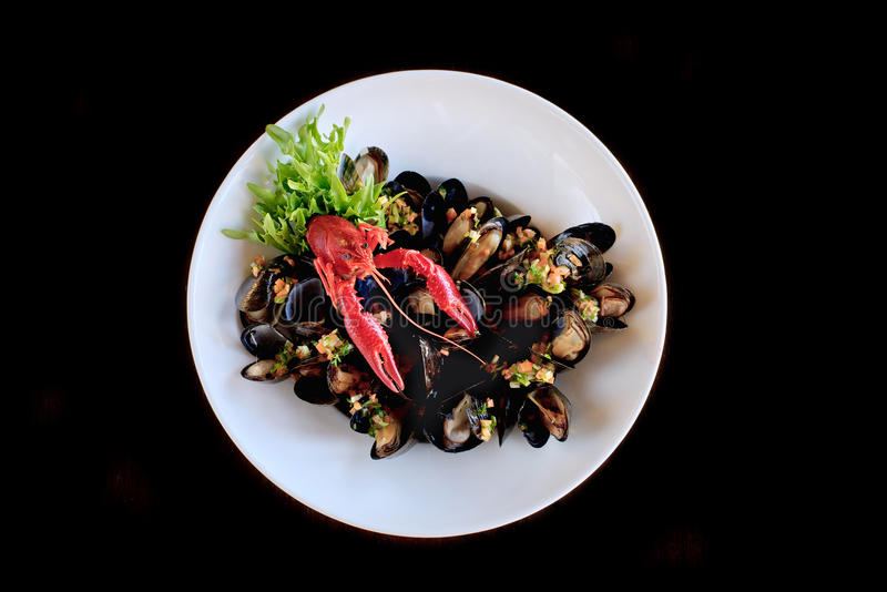 Plate with crawfish with mussels royalty free stock photos
