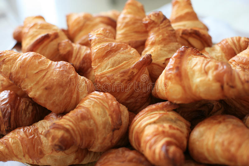Plate with croissants. Plate with fresh baked croissants stock image