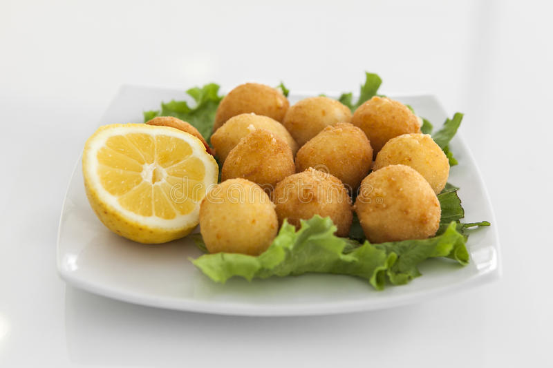 A plate with croquettes stock photography