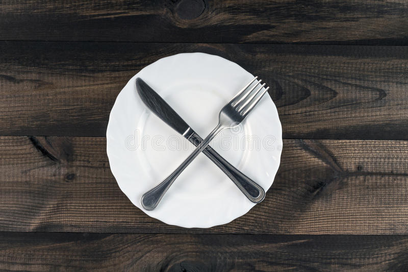 Plate with crossed fork and butter knife stock photography